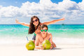 Young loving happy couple have fun on tropical beach, with cocon Royalty Free Stock Photo