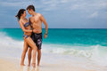 Young loving happy couple on tropical beach the sea in the background Royalty Free Stock Photos