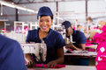 Young machinist sewing portrait of african Stock Image