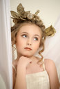 Young magic fairy with gold flowers Royalty Free Stock Photo