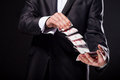 Young magician showing tricks using cards from deck. Close up. Royalty Free Stock Photo