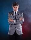 Young magician in suit on a dark background Stock Photos