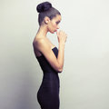 Young magnificent girl portrait of in black dress Stock Image