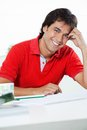 Young male architect smiling portrait of handsome in casual t shirt while sitting at desk Stock Images