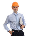 Young male architect wearing helmet and holding laptop isolated on white background Stock Photo