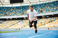 Young male athlete running on a racetrack Royalty Free Stock Photo