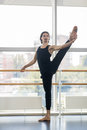 Young Male Ballet Dancer Posing Near Barre, Hispanic Man Practicing Stretch Royalty Free Stock Photo