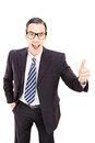 Young male businessman giving thumb up isolated on white backgro background Stock Photo