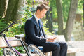 Businessman Sitting On Bench Using Mobile Phone Royalty Free Stock Photo