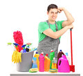 Young male cleaner with cleaning equipment Royalty Free Stock Photos