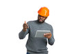 Young male engineer gesticulating with tablet. Royalty Free Stock Photo