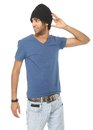 Young male fashion model in jeans and black hat Royalty Free Stock Photo