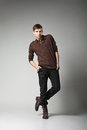 Young male fashion model posing casual outfit grey background Stock Photography
