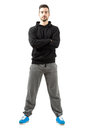 Young male with folded hands in the sportswear or crossed full body length isolated over white background Stock Photography