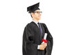 Young male graduate student holding a diploma Royalty Free Stock Photography