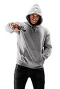 Young male with hood over his head holding a gun symbolizing cr crime isolated against white background Royalty Free Stock Image