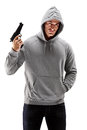 Young male with hood over his head holding a gun symbolizing crime isolated on white background Stock Images