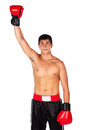 Young male kickboxer handsome caucasian wearing red boxing gloves and kickboxing gear isolated on a white background Stock Image