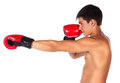 Young male kickboxer handsome caucasian wearing red boxing gloves and kickboxing gear isolated on a white background Royalty Free Stock Image