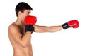 Young male kickboxer handsome caucasian wearing red boxing gloves and kickboxing gear isolated on a white background Stock Images