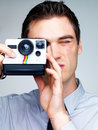 Young male photographer shooting pictures Royalty Free Stock Photo