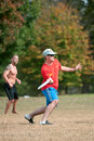 Young Male Plays Ultimate Frisbee In Park Royalty Free Stock Photo