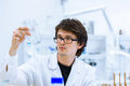 Young male researcher carrying out scientific research in a lab shallow dof color toned image Royalty Free Stock Photo