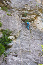 Young male rock climber on red Stock Image