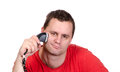 Young male shaving with electric shaver closeup of a Royalty Free Stock Photography