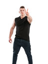 Young male stud showing peace sign with two fingers on white background Royalty Free Stock Photography
