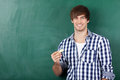 Young male student in front of chalkboard portrait handsome Stock Image