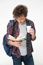 Young male student standing with book Royalty Free Stock Photo