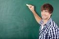 Young male student writing on chalkboard portrait of handsome Stock Image