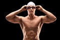 Young male swimmer with black swimming goggles on background Stock Images