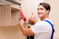The young man assembling kitchen furniture Royalty Free Stock Photo