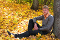 image photo : Young man in autumn forest