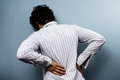 Young man with back pain severe from sciatica is barely able to move Stock Image