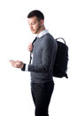 Young man with backpack looking at smartphone Royalty Free Stock Photo