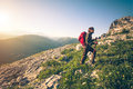 Young man with backpack mountaineering outdoor travel lifestyle concept mountains on background summer vacations Royalty Free Stock Photos