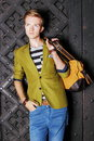 Young man with bag on street old town gdansk handsome fashion model casual style of poland europe Stock Image