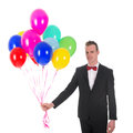 Young man with balloons Royalty Free Stock Photo