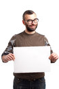 Young man with beard holding blank board portrait of handsome Stock Photo