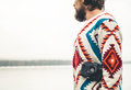 Young man bearded with retro photo camera fashion travel lifestyle wearing knitted sweater clothing outdoor foggy nature on Stock Photography