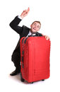 Young man behind red luggage Royalty Free Stock Photo