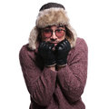 Young man is being scared about the winter cold dressed in clothes and warm fur hat of on white background Stock Image