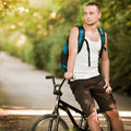 Young man on bike Stock Photo