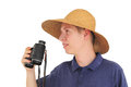 Young man with binoculars and straw hat Stock Photography