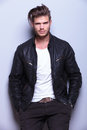 Young man with a black leather jacket smiling Royalty Free Stock Photo