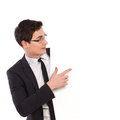 Young man in black suit pointing at the banner. Royalty Free Stock Photo