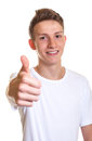 Young man with blond hair laughing at camera and showing thumb up attractive his right on an isolated white background Royalty Free Stock Images